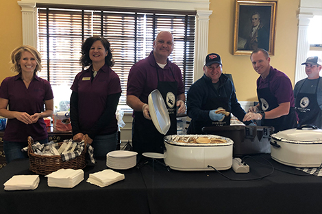 Jefferson Bank employees giving back to the community by serving food