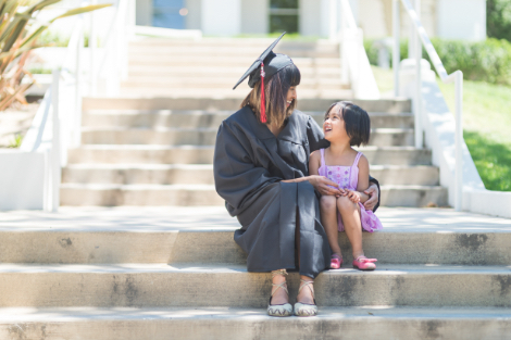 A mother and daughter sitting on campus steps together