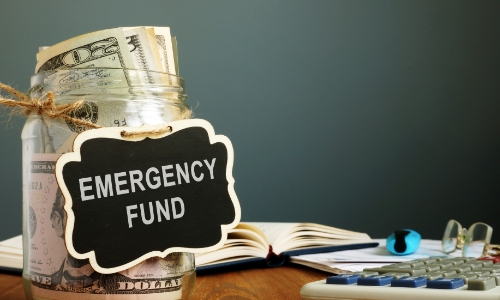 A jar of money labeled emergency fund