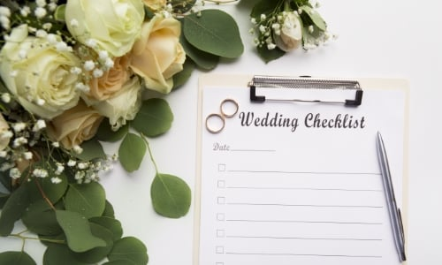 A wedding checklist attached to a clipboard